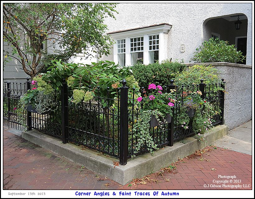 Picture Of Two Corner Angle Lengths Of A Wrought Iron Fence With A