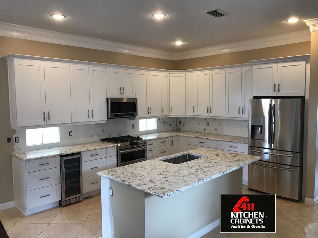 White Shaker Cabinets Reappear Again But This Time With Montclair White Quartz Proving Onc In 2020 White Shaker Kitchen Cabinets White Shaker Kitchen Shaker Cabinets