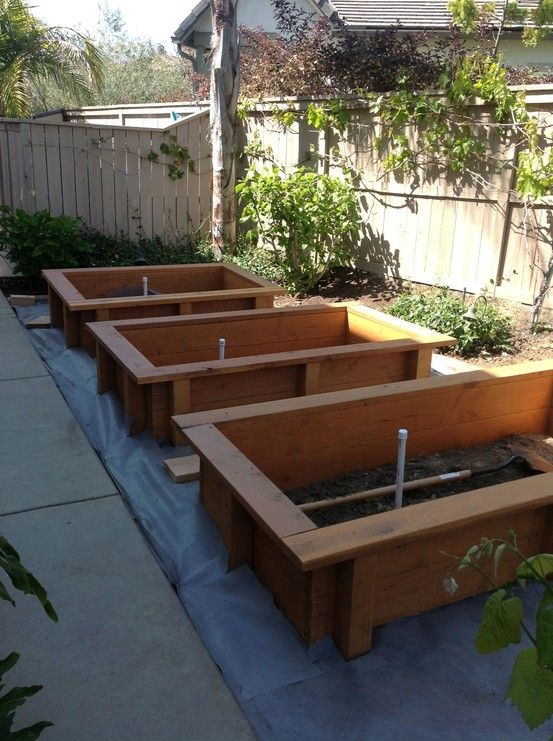 Our brand new planter boxes that we just had built...can't wait to fill them