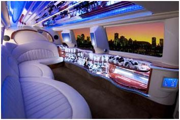 A bar? A playroom? A nightclub? A penthouse? Nope! It is the interior of a 14 passenger Ford Excursion from the Chicago Limo Company Interior design has now spread to your 'personal transportation' With its multi-screen television and computer screens, fully equipped bar and bathroom,  this has to be a great way to cross the desert.