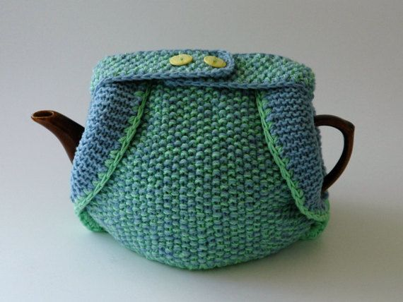 Knitted tea cosy in blue and green wool with lemon buttons