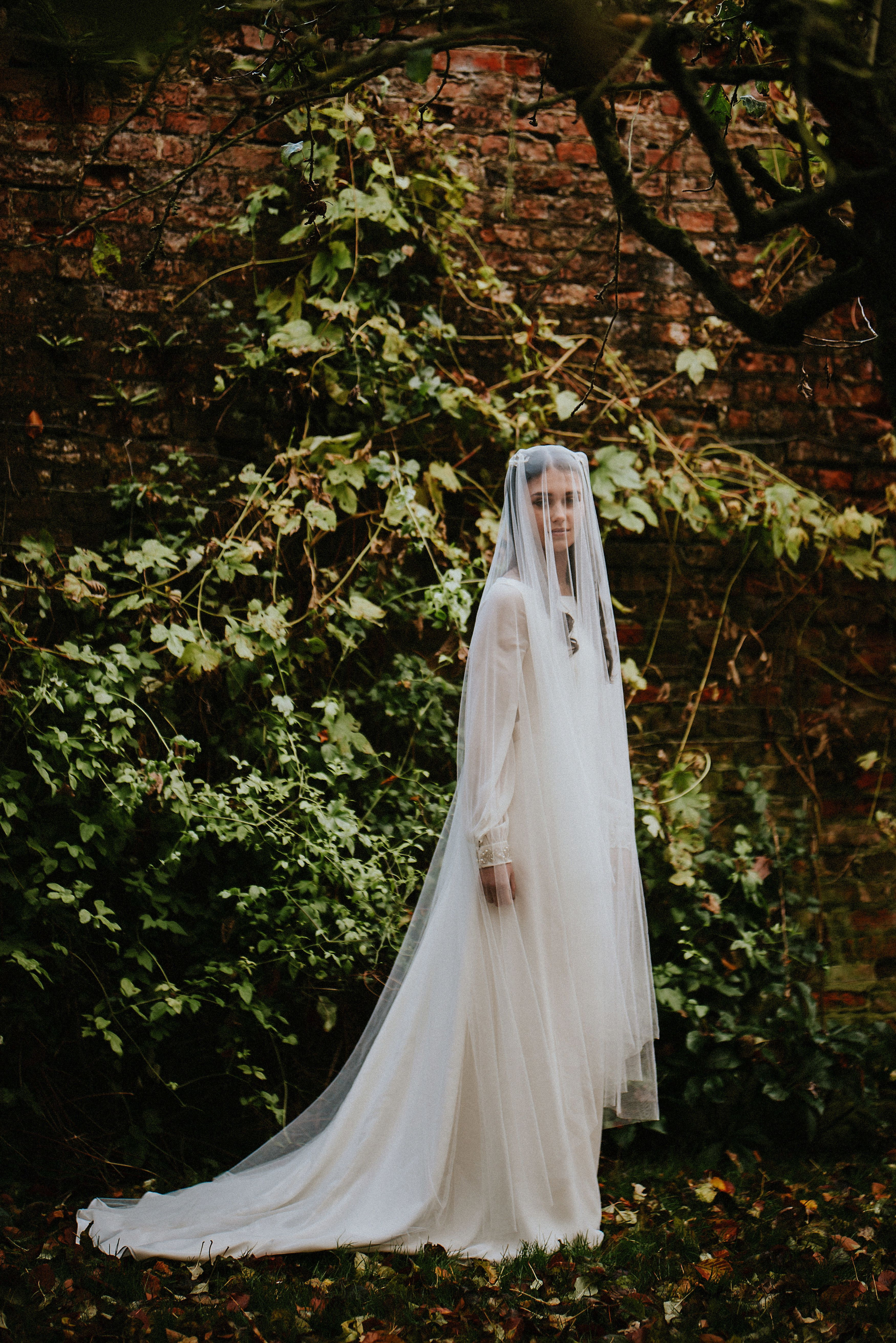Sheer long sleeve wedding dresses  The Bluebell dress by Rolling In Roses Ivory long sleeved wedding