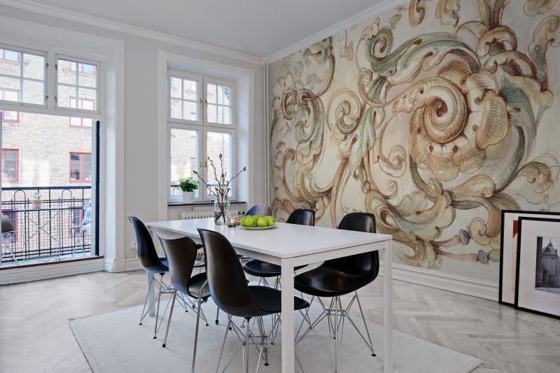 A large hand painted ornament in watercolor offers an exciting mix of contemporary and baroque