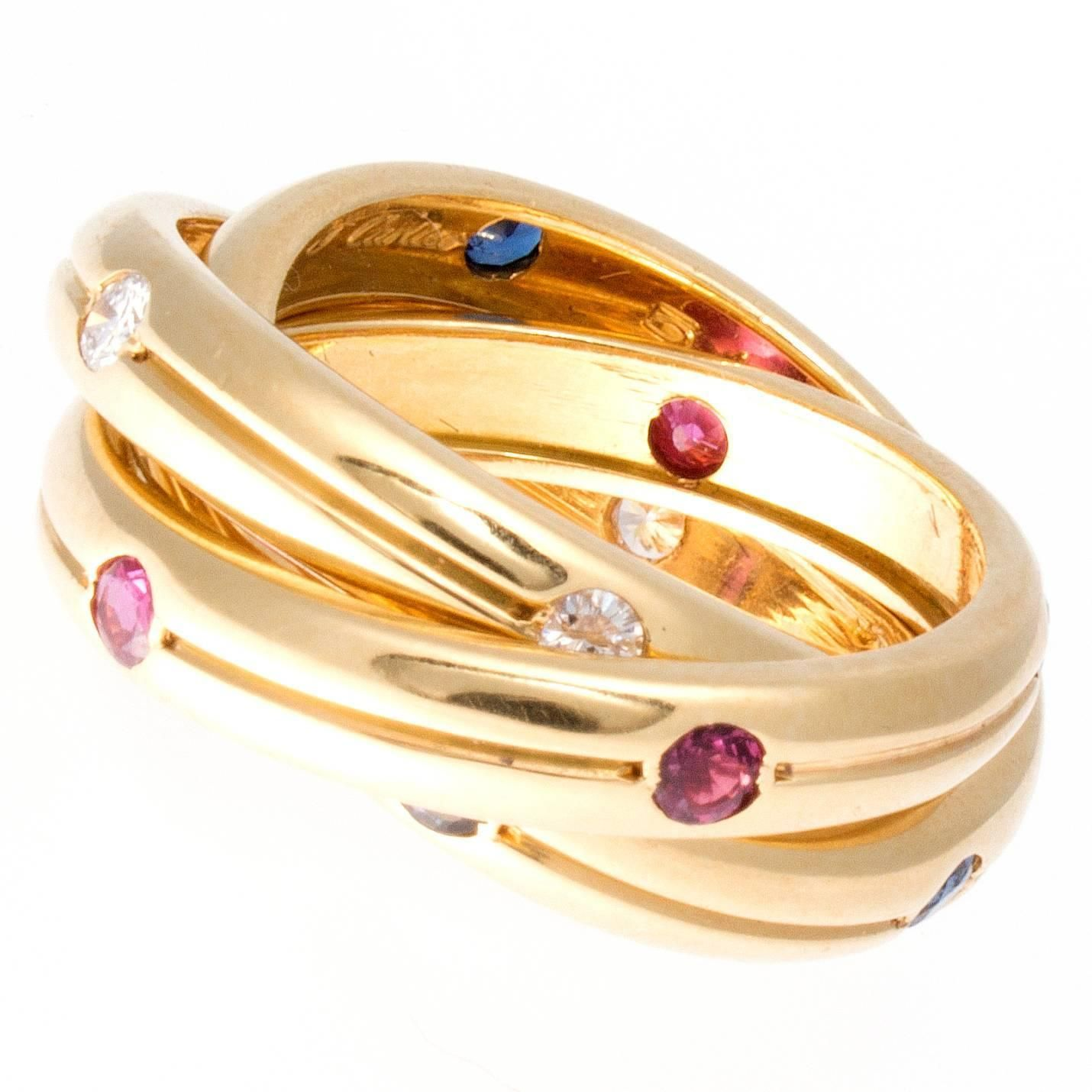 Cartier Trinity Ruby Sapphire Diamond Gold Ring | From a unique collection of vintage more rings at https://www.1stdibs.com/jewelry/rings/more-rings/