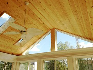 Skylights And A Beautiful Pine Cathedral Ceiling Give This Sunroom An Open And Sunny Fe Cathedral Ceiling Living Room Vaulted Ceiling Living Room Small Sunroom