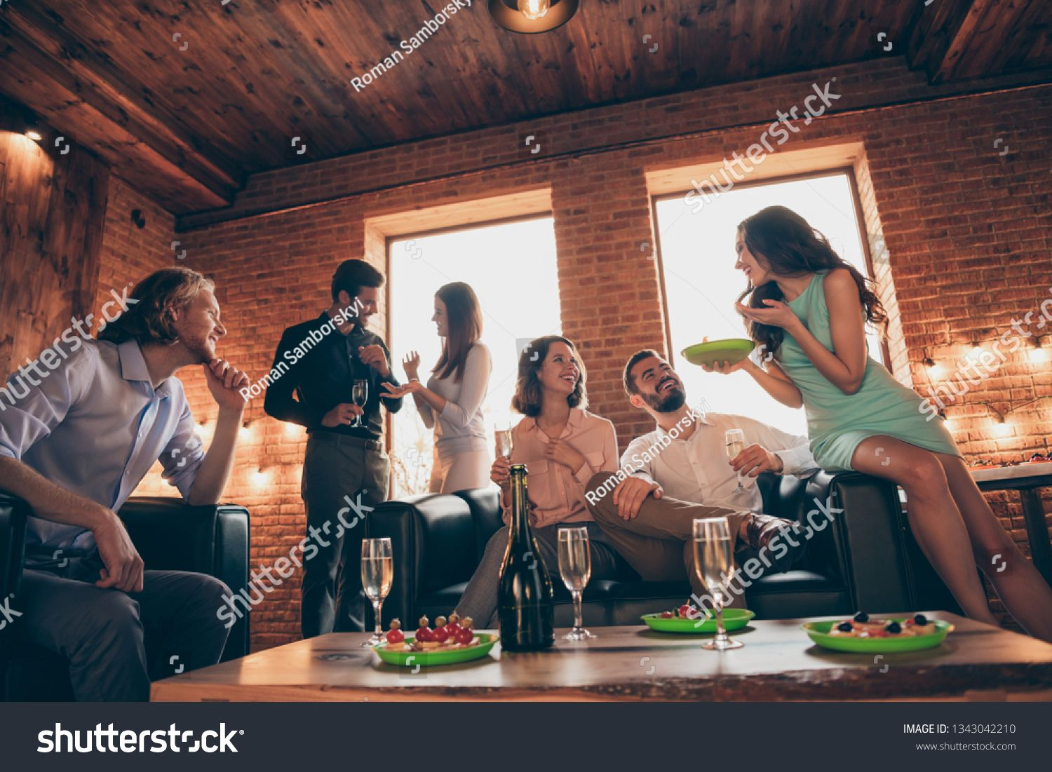 Close up photo funny event social members company buddies dessert she her ladies he him his guys wineglasses golden wine beverage wear dresses shirts formalwear hang out sit sofa loft room indoors ,