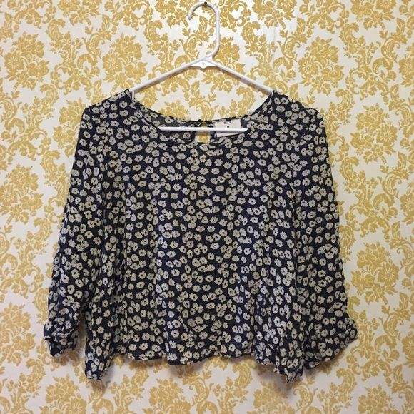 Flirty Floral Crop Top Navy blue, flowy crop top with white flowers. The sleeves are 3/4 length. Pins & Needles Tops Crop Tops