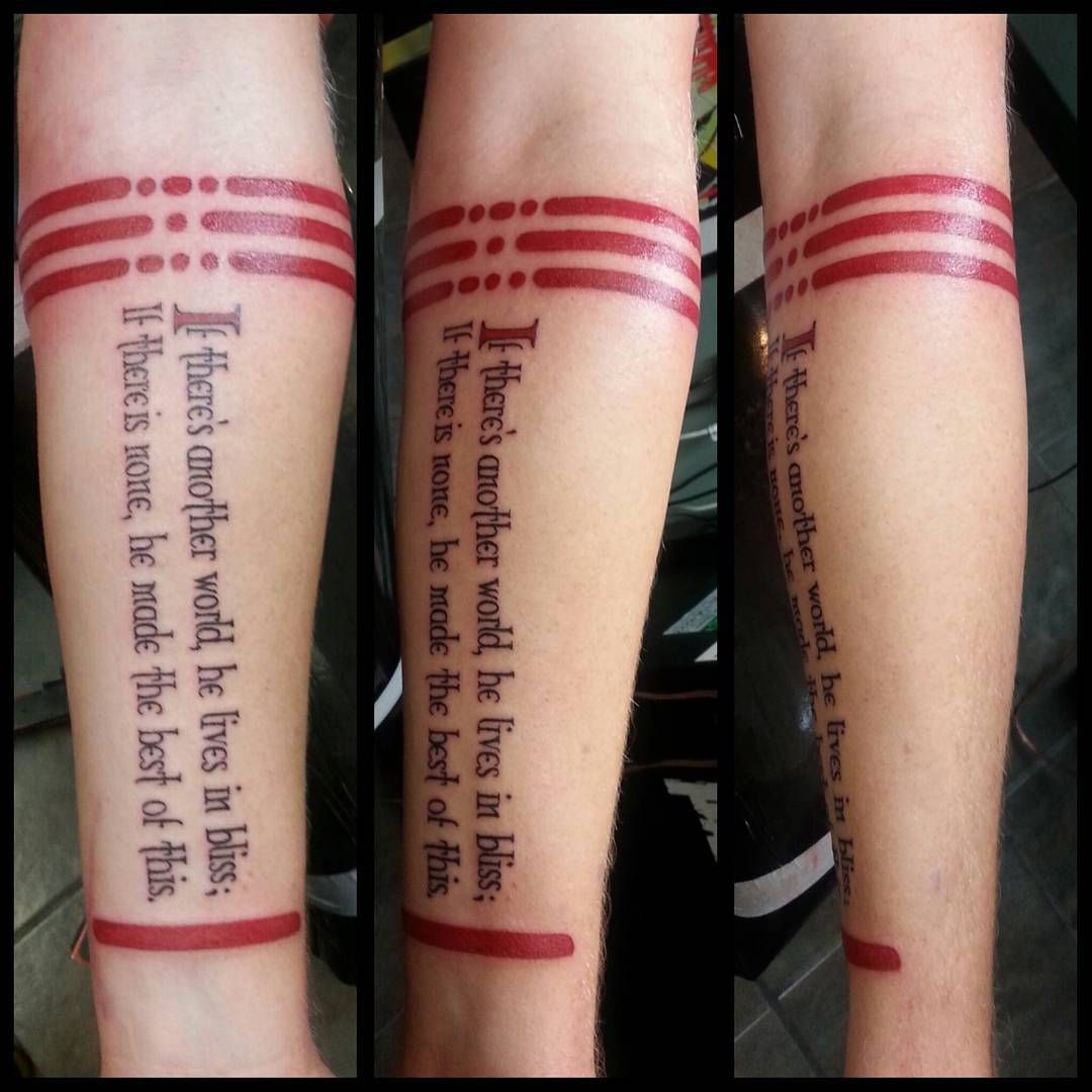 Greg Paradis text black and red forearm tattoo