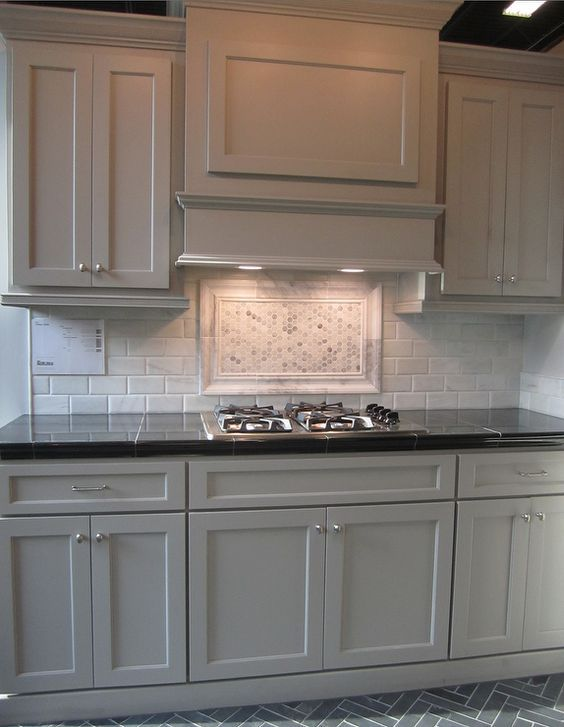 Kitchen Backsplash Accents gray cabinets; black counters; slate herringbone floor; marble hex