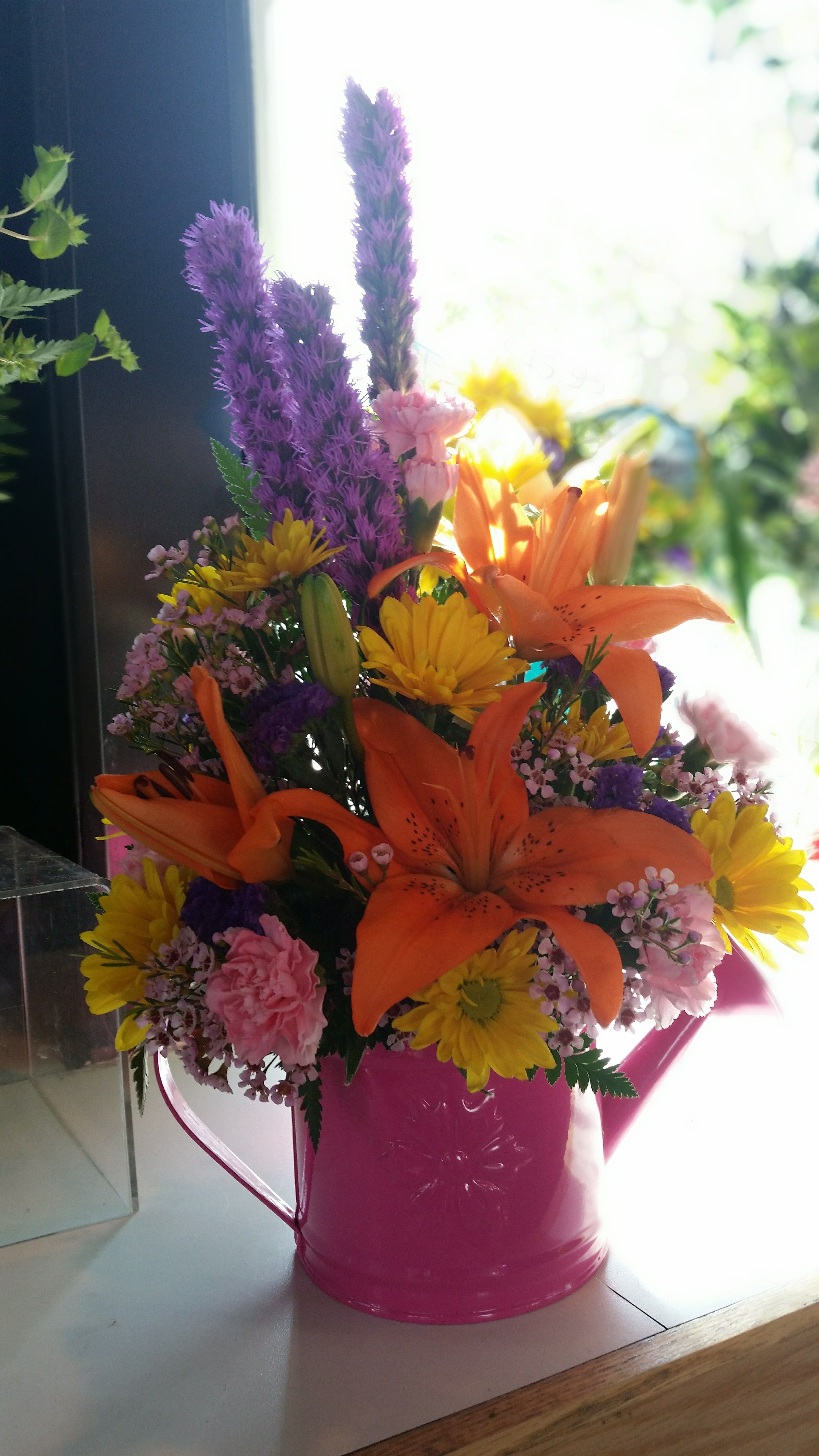 Spring Arrangement In Keepsake Watering Can Give The Gift Of