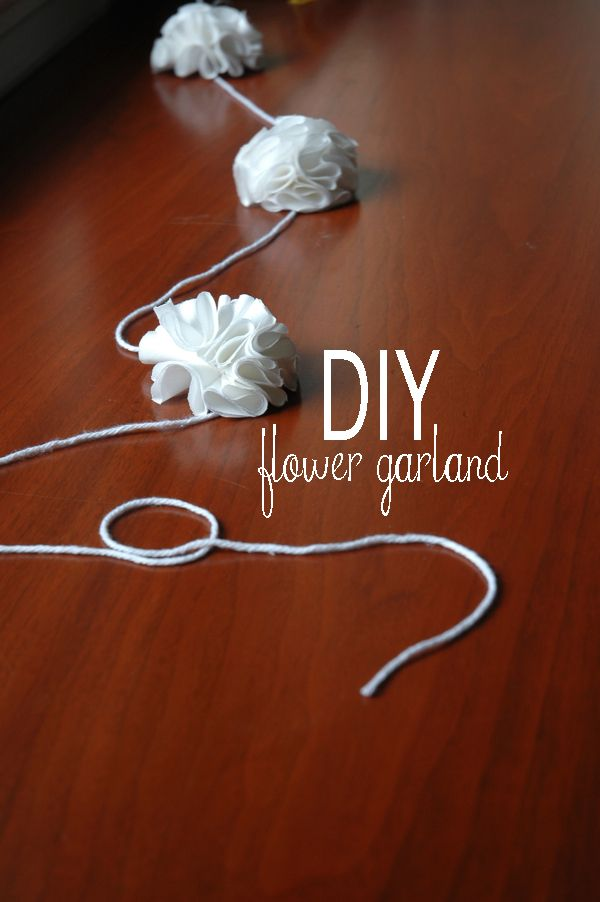 Day #8  Perfect for this rainy ol day with a sick kid in bed.  DIY Flower Garland