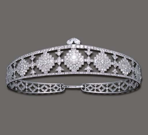 ELEGANT ART DECO NATURAL PEARL AND DIAMOND BANDEAU, BY CARTIER   The openwork old European-cut diamond tapering band, of geometric design, centering upon a pearl, measuring approximately 13.10 mm, enhanced by two pear-shaped diamonds, mounted in platinum, circa 1924 $298,700.00