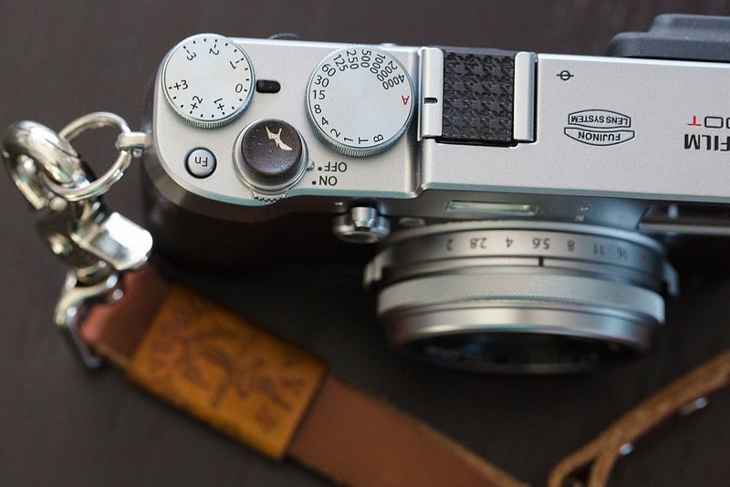 My Fuji X100T with soft release and hot shoe protector by Artisan Obscura. Custom leather wrist strap by The Gentleman's Agreement