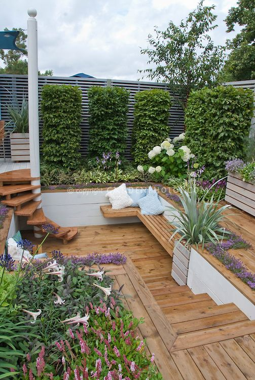 Sunken deck and steps stairs with hydrangeas in bloom for Sunken outdoor seating