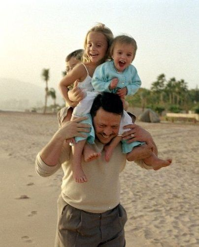 King Abdullah II of Jordan giving three of his little ones a piggy back ride... *melts*
