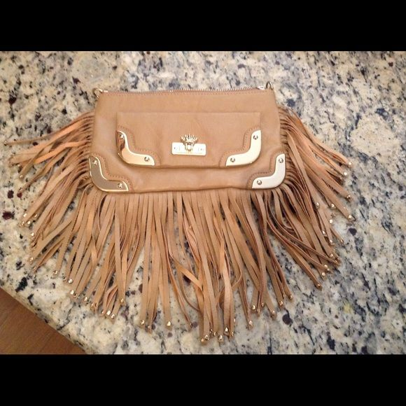 Christian Audigier clutch purse. Tan. This is a leather fringe Christian Audigier purse or clutch.  It originally came with a chain strap.  I'm not sure where I put it.  One little scratch on the metal and three fringes have fallen off.  No one can see.  It has a magnetic flap on the outside. Inside it has animal print and tags with serial number. Christian Audigier Bags