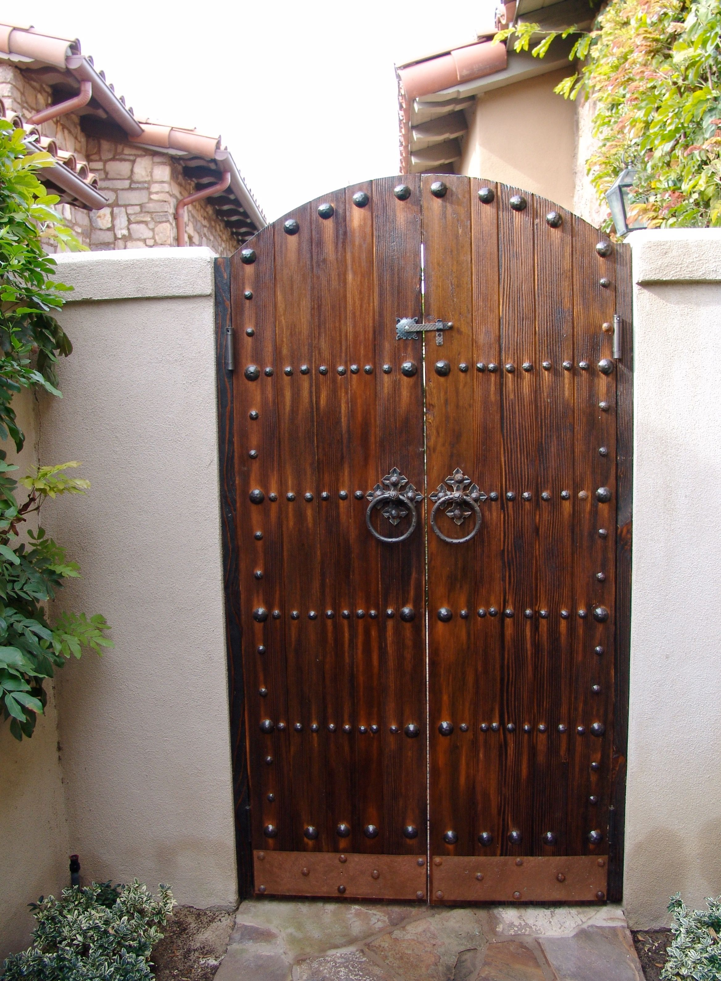Spanish Style Gates Comprise Dark Wood Or Stains That