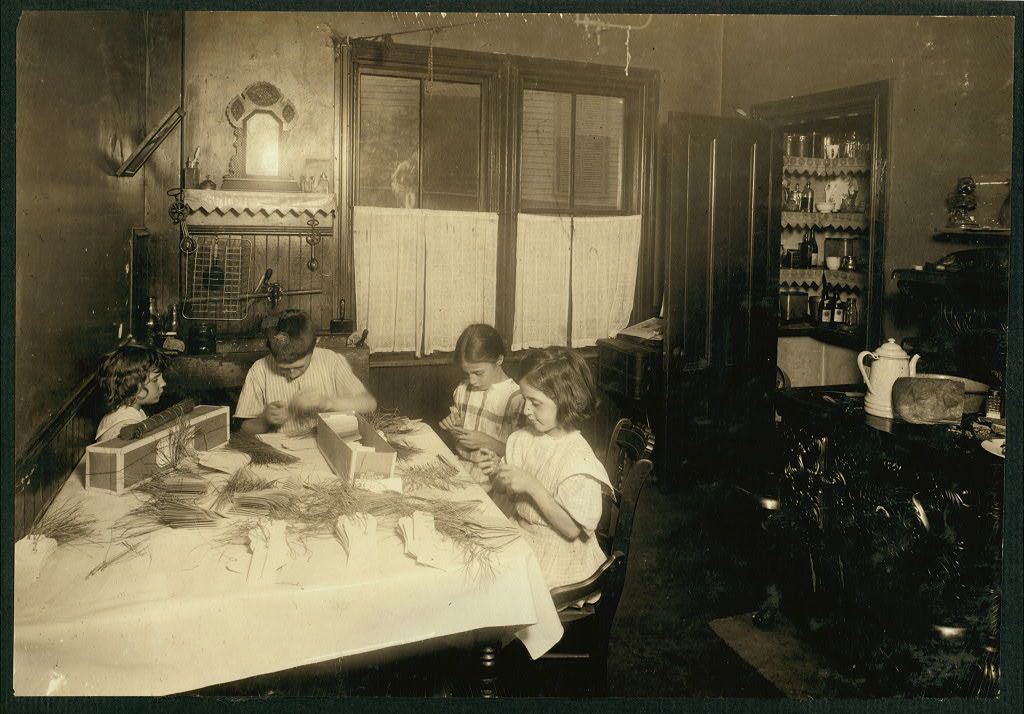 Home work on tags. Home of Martin Gibbons, 268 [?] Centre Street, Roxbury Mass. James 11, years old; Helen 9 years and Mary 6, work on tags. Helen said she could tie the most (5,000 a day at 30 cents). Mary does some but can do only 1000 a day. They work nights a good deal. The night before Helen and James worked until 11:00 P.M. See also Home Work report. Location: Roxbury, Massachusetts. | Library of Congress