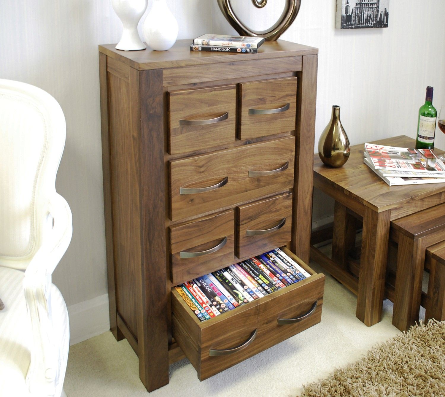 This Mayan Walnut DVD / CD Storage Chest Is The Perfect Storage Solution.  It Could