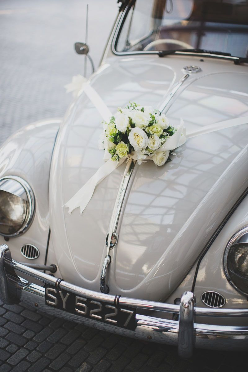 Simple and rustic wedding car flowers on a vintage wedding car see the full wedding feature of claire and tammys rustic garden wedding in alkaff mansion