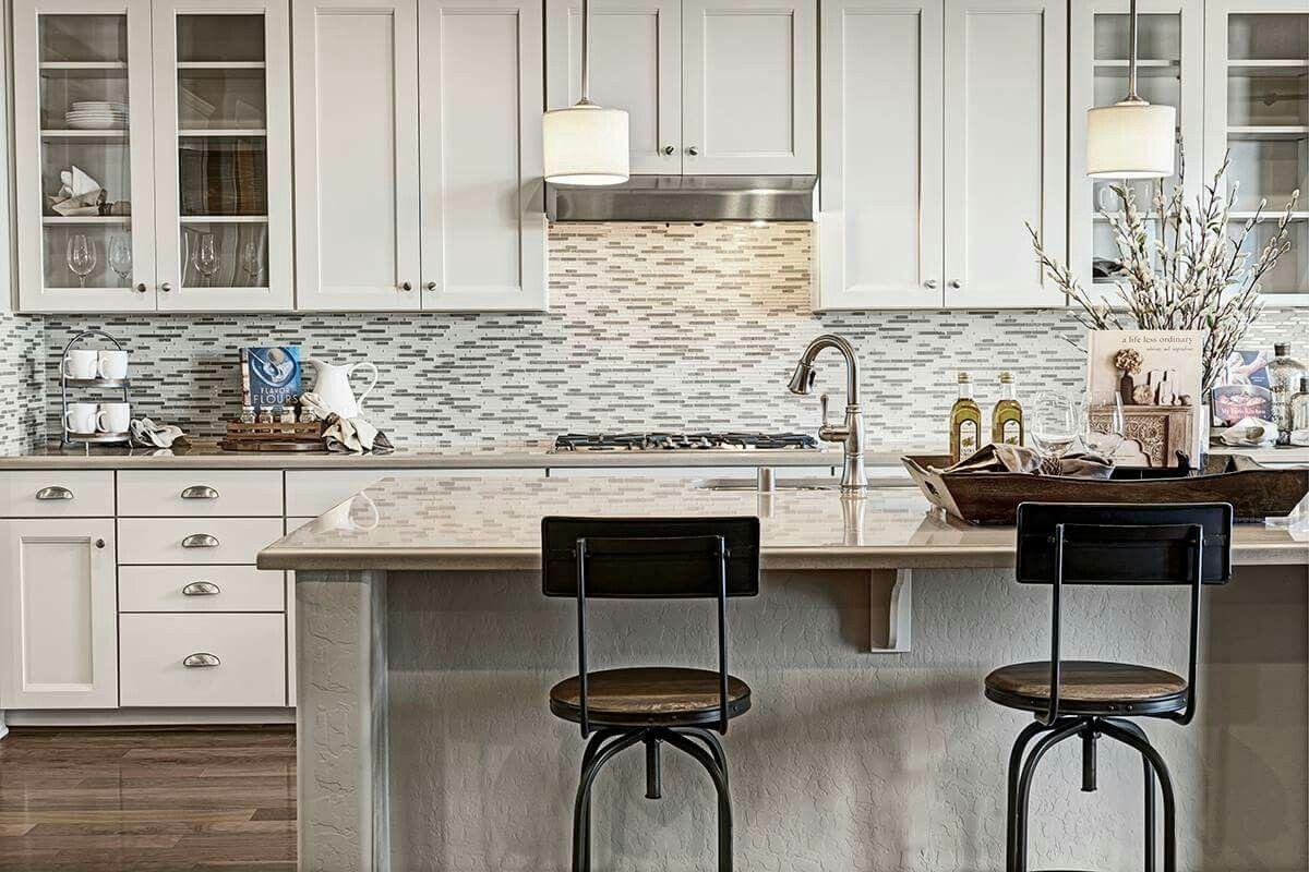 White cabinets, neutral granite and a rounded island are just a few ...