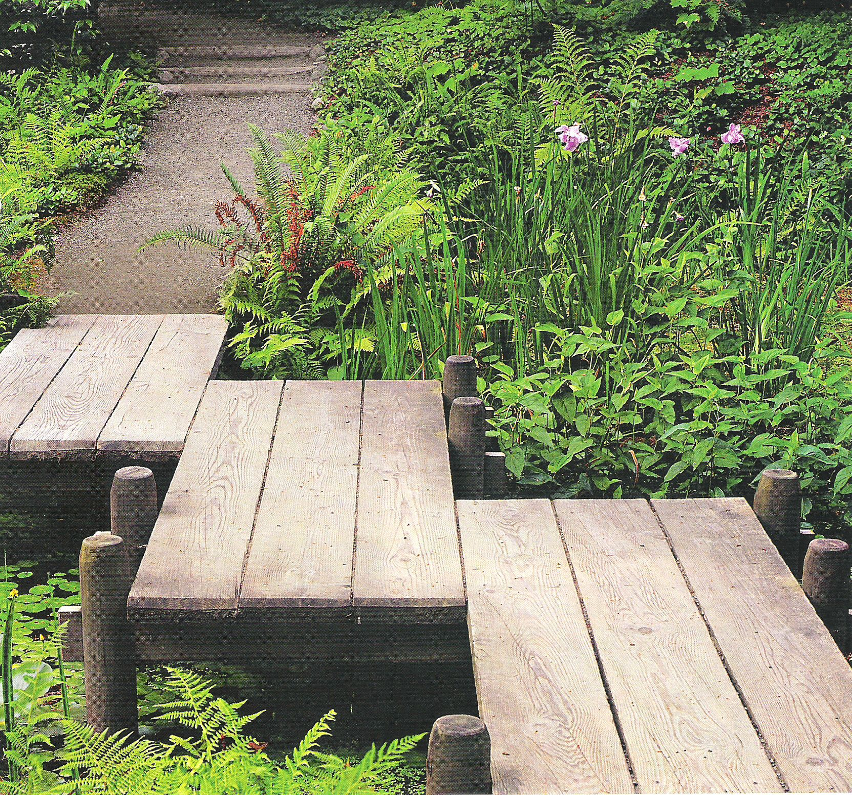 Simple Water Features For The Garden: An Easy Bridge Over The Water Feature