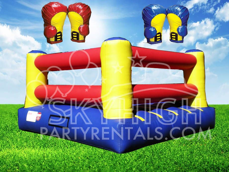 An Inflatable Boxing Ring with 2 pairs of gloves