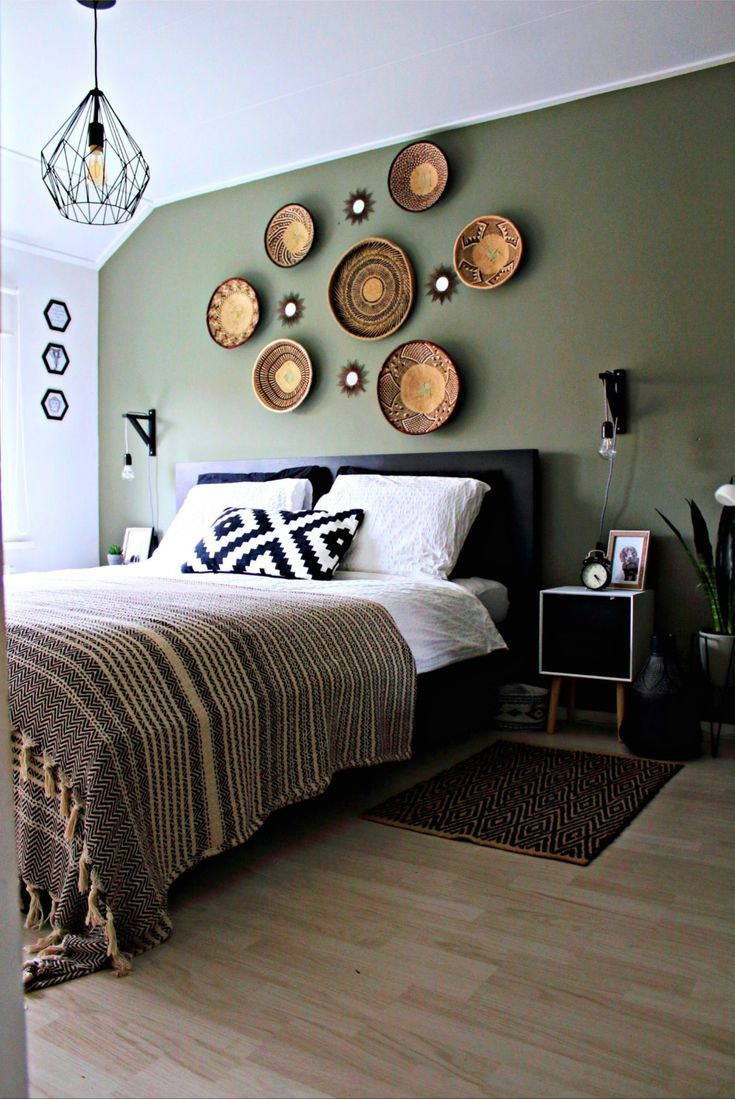 Black, white and camouflage green bedroom with African