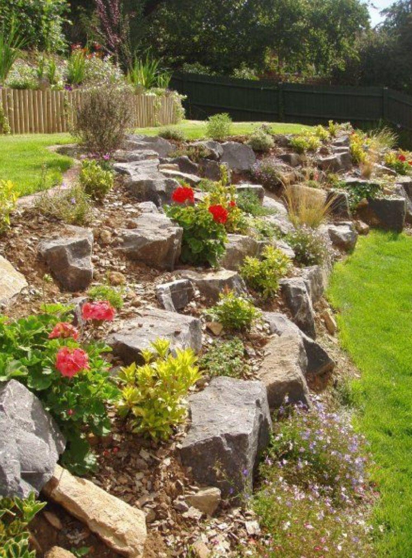 Large Rocks Retain A Sloped Area Rock Garden Design Rock Garden Landscaping Sloped Backyard