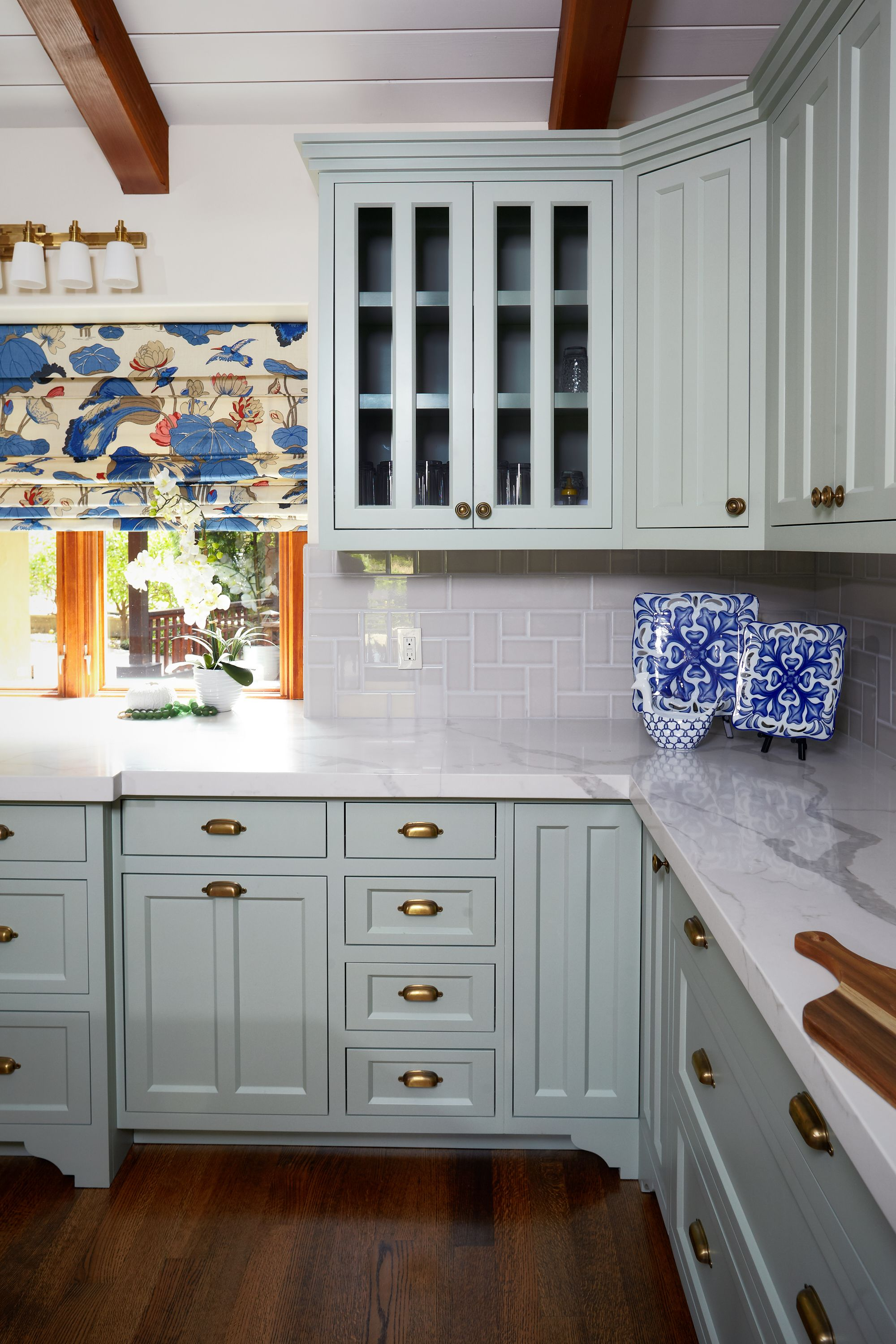 This Oversized Craftsman Kitchen Is So Charming With It S Patterned Roman Shades Marble Counters Robin S Egg Craftsman Kitchen Kitchen Remodel Hill Interiors