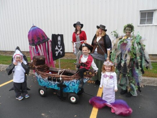 Pirate theme Halloween group costumes. Cardboard ship on wagon shark costume from felt 3 pirate costumes from basic pieces a mermaid a jellyfish made ...  sc 1 st  Pinterest & Pirate theme Halloween group costumes. Cardboard ship on wagon ...