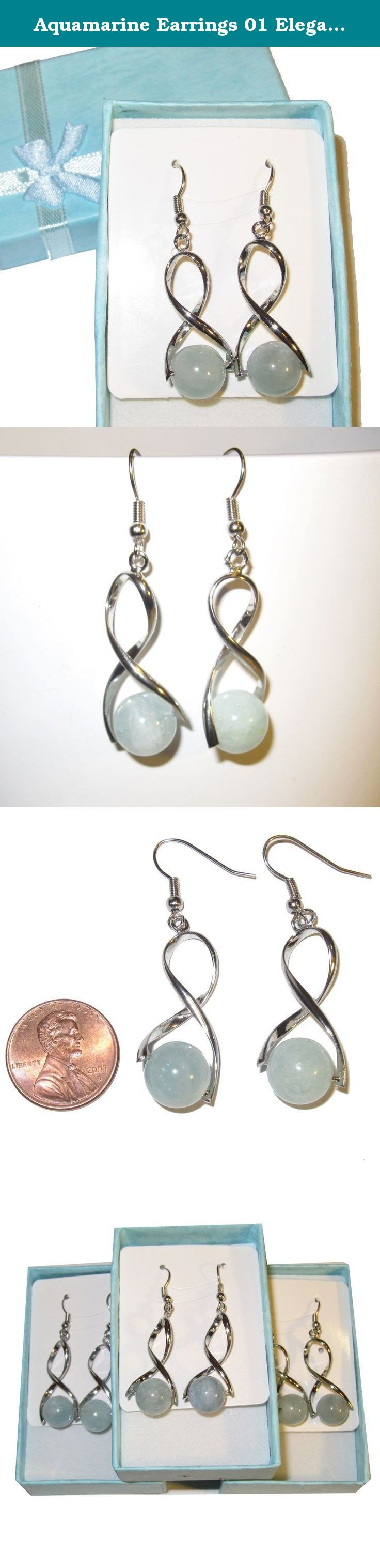 """Aquamarine Earrings 01 Elegant Blue Natural 10mm Gemstone Healing Crystals Twisted Silver Artisan 1.8"""" Dangle (Gift Box). Crystal Jewelry This beautiful pair of crystal earrings is made from genuine aquamarine gemstones. The stones are round with aqua blue tones, each varying slightly from the next, and natural patterns. They are suspended upon elegant and fun twisted silver metal design and hooks. The earrings comes in a gift-ready Satin Crystals box. Receive one pair per order, from a..."""