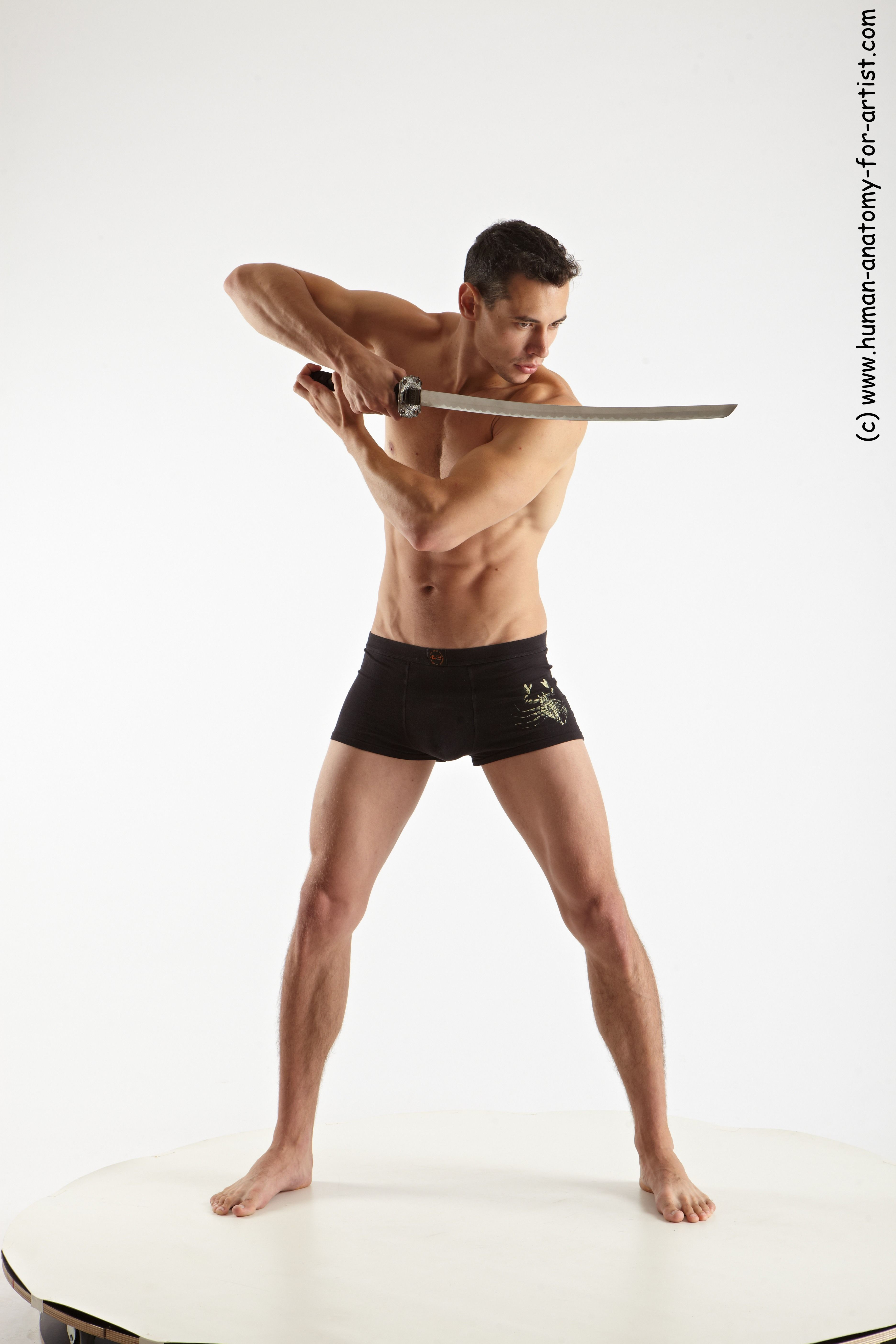 Photo Of Underwear Fighting With Sword Man White Athletic Short