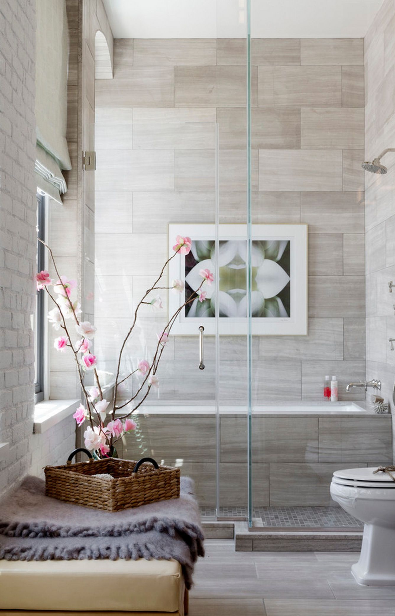 Minimal bath room with a bench over shower. Ideal for rest and relax ...