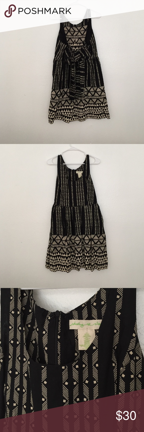 NWOT Urban Outfitters Black/White Print Dress NWOT black and white dress in a geometric print. Features a bow tie in the back of the dress (multiple ways to style) and pockets!!Brand is Staring at the Stars and it was purchased at Urban Outfitters. Size: 12. Urban Outfitters Dresses Mini