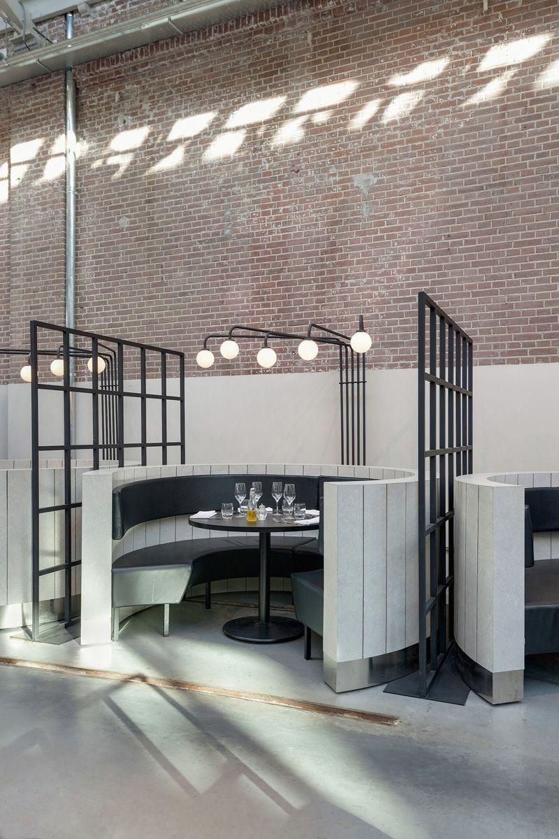 Framework Studio, designed the interior of Meat West, a restaurant located inside De Hallen, a former tram repair depot in Amsterdam.