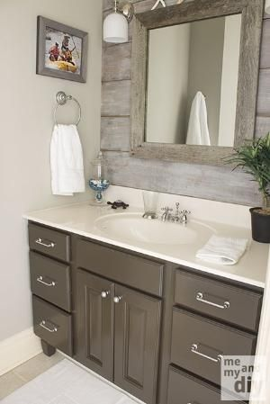 weathered tones mixed with gloss grey bathroom cabinet- LOVE the wood behind the mirror by Boglárka
