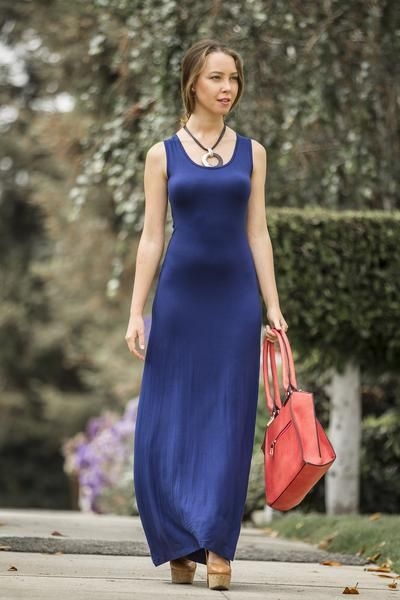 Beautiful long navy blue dress with unique stitched back. Wear for a fun day out or an early evening with friends. Combine with your favorite bag and jewelry an