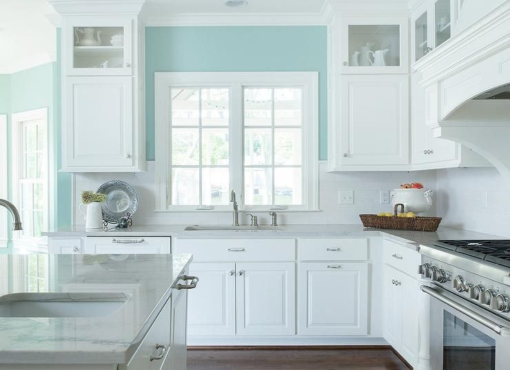White and turquoise kitchen features walls painted for Blue kitchen walls with white cabinets