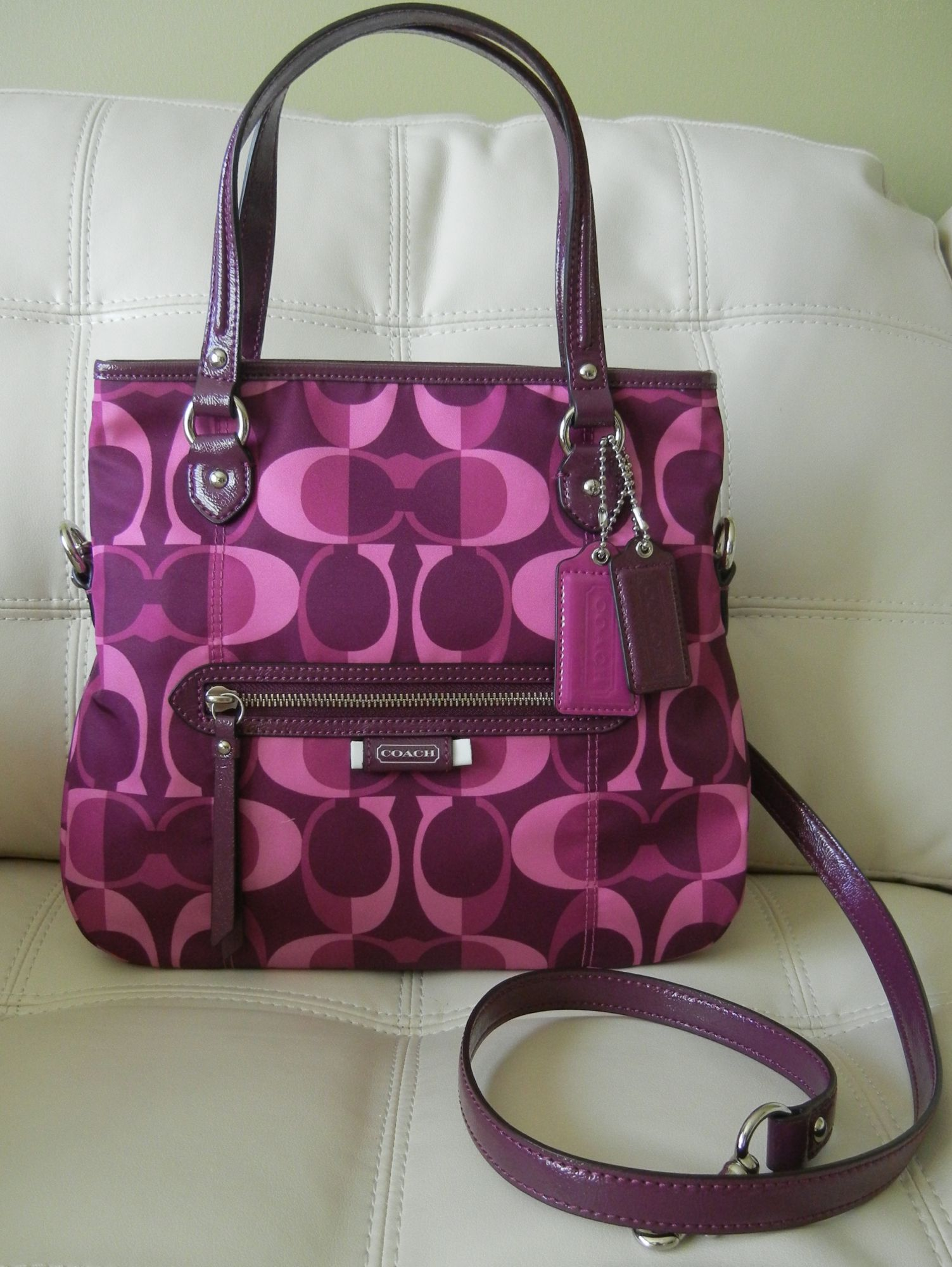 This Colorful Flirty Bag from Coach is a sure hit! With its Split C Fabric  in Delicious Berry it is a Perfect Handbag for the Upcoming Spring Weather. 3b0a1f20b88e7