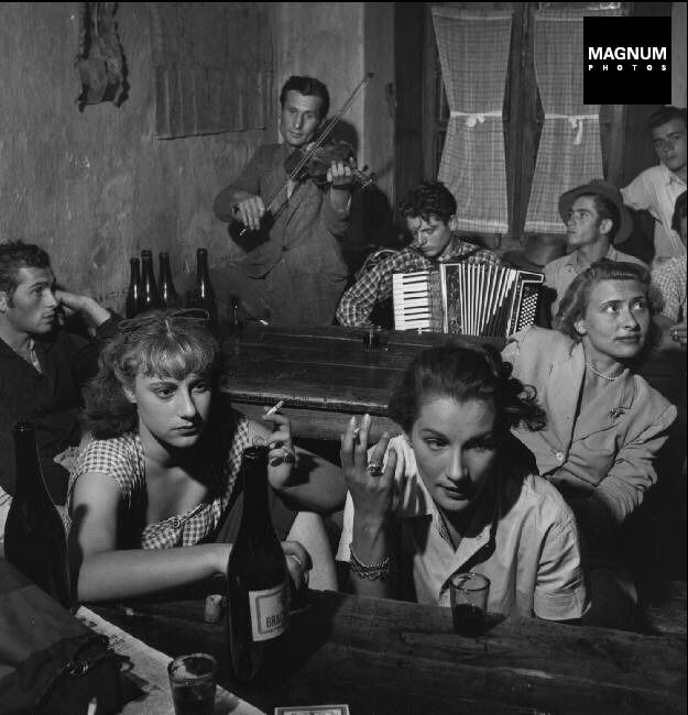 Doris Dowling [front right] during filming of 'Riz Amer' in 1950//Robert Capa