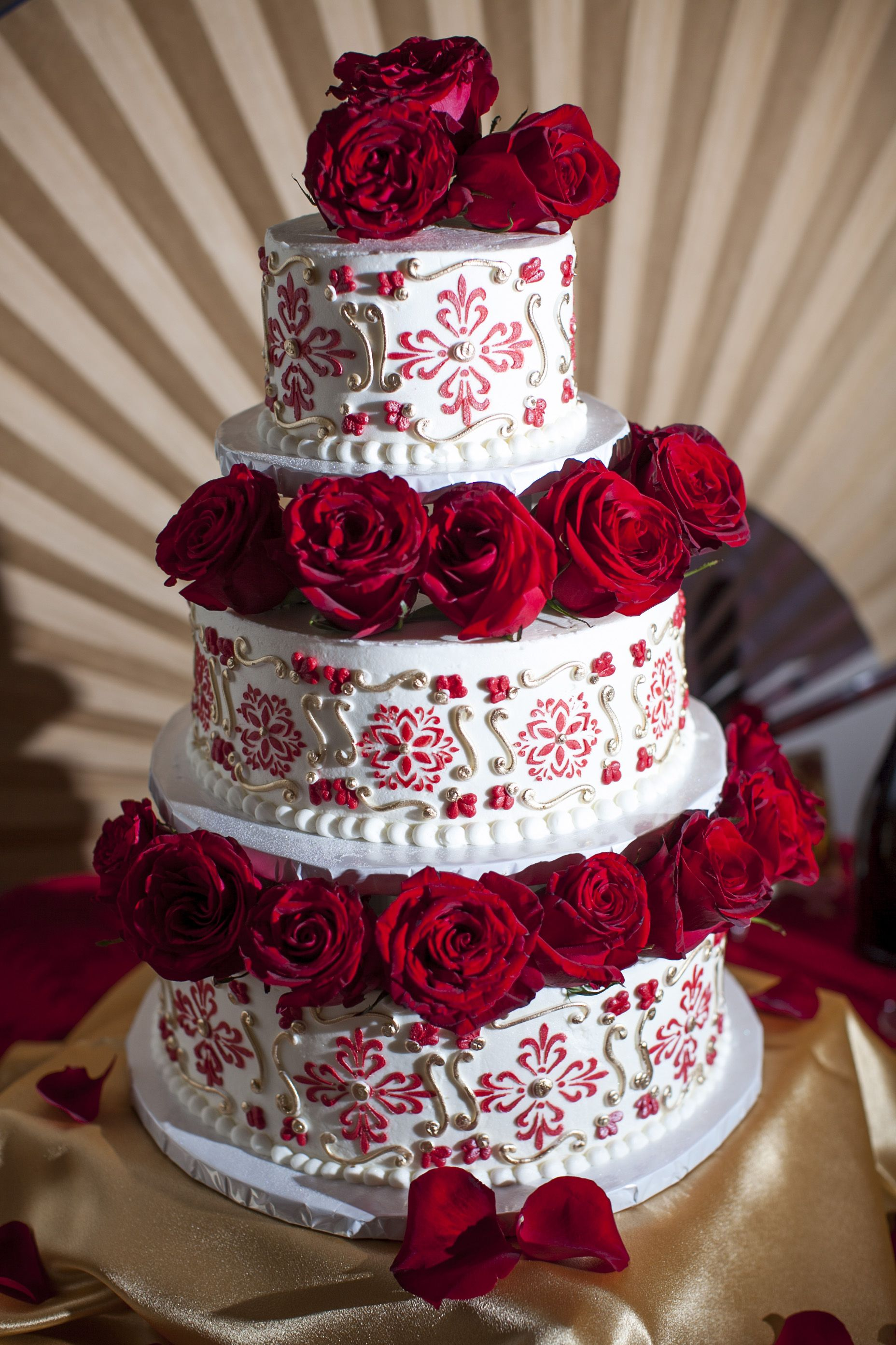 Spanish (Spain) themed wedding cake with roses. We wanted