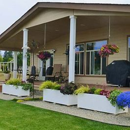 large rectangular planters in front of house