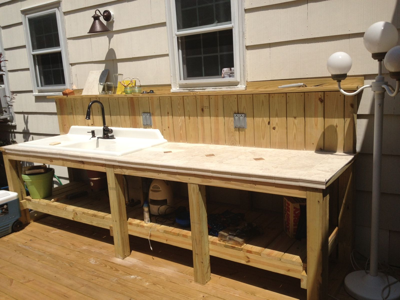 outdoor sink and countertop area plete with garbage disposal