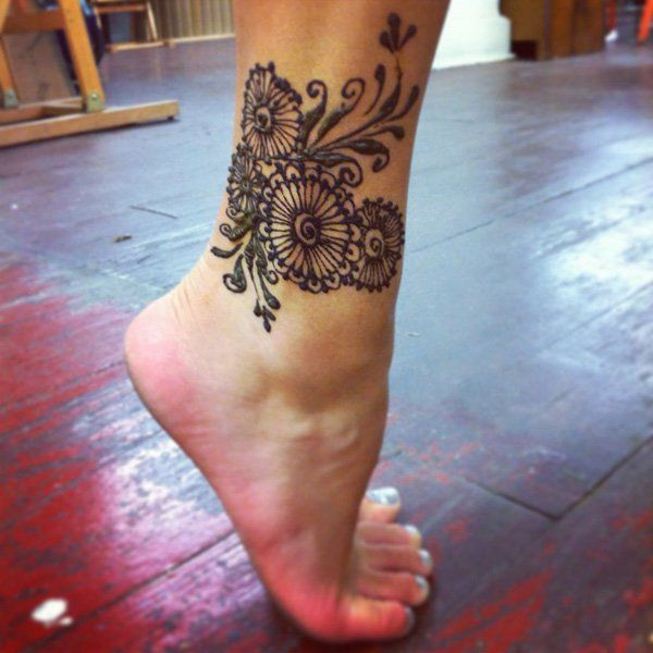 Beautiful ankle tattoo design and ideas for women ankle for Wrap around ankle tattoos