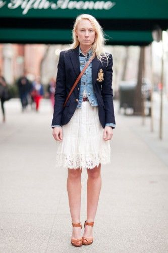 I love layering a classic schoolboy blazer over a denim jacket or vest like Lisa does here. The denim roughs up an otherwise preppy outfit. This is layering at its very best.