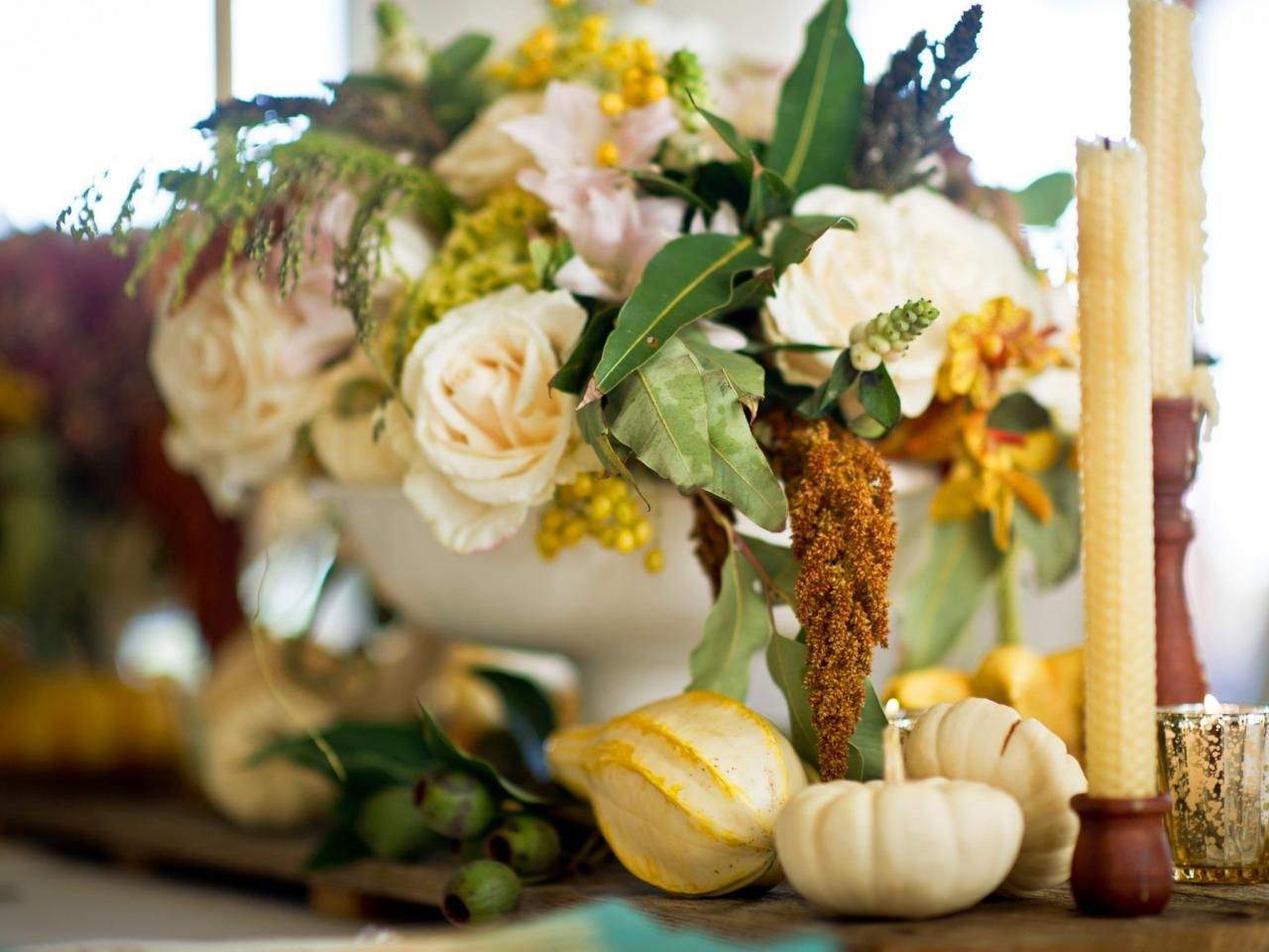 Designer camille styles pairs rustic elements like beeswax candles