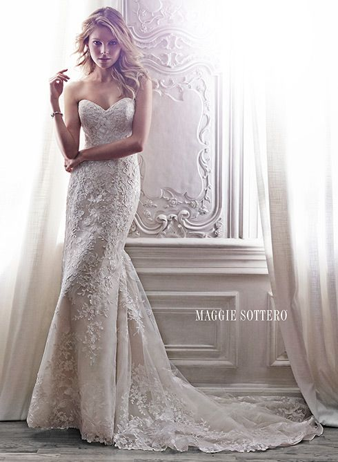 Arlyn - by Maggie Sottero This lace slim A-line gown channels timeless elegance with its classic sweetheart neckline, cascading floral lace appliqués, lace-trimmed hemline and optional lace cap-sleeves. Finished with corset closure or crystal button over zipper closure with inner corset.