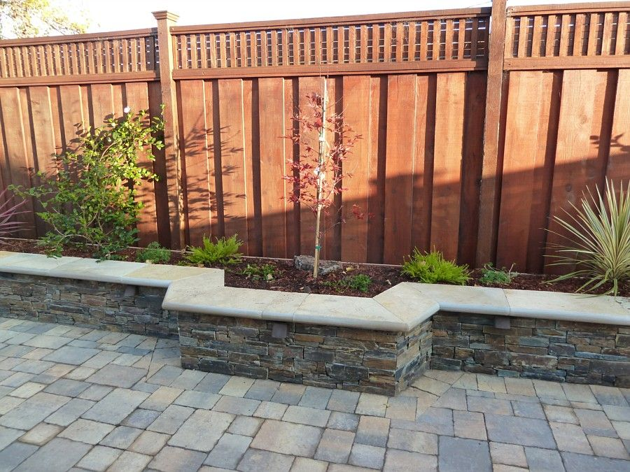 Brick paver planters against fence backyard paving for Outdoor wall planter ideas