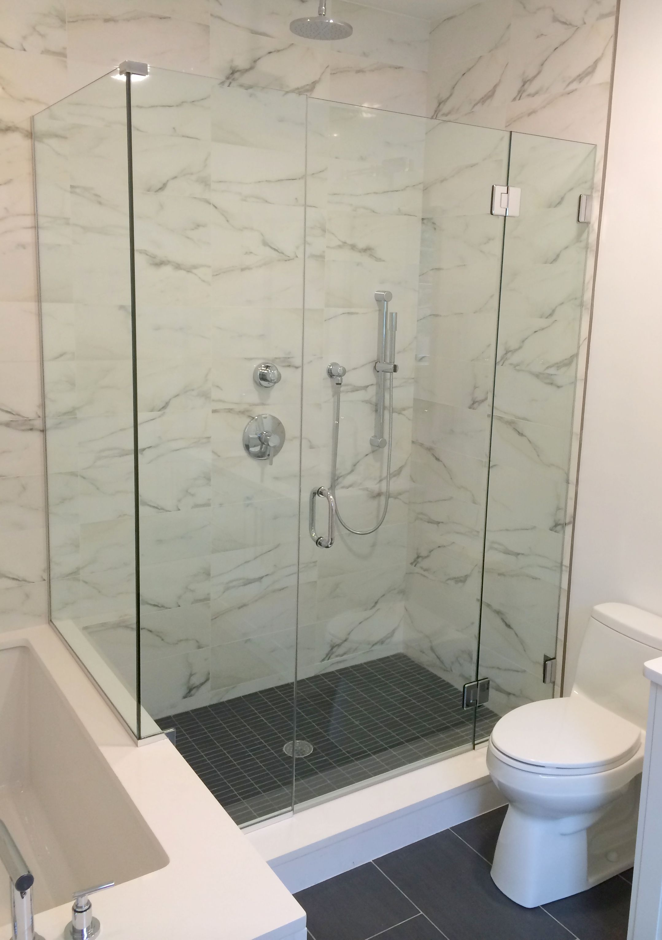 frameless shower doors can also be supported by glass clips and horizontal uchannel